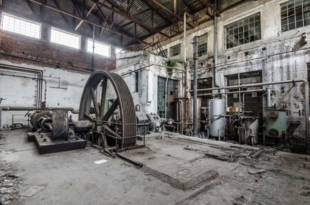 big wheel in an old abandoned factory