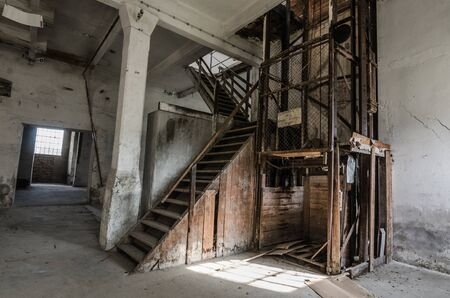 old elevator and wooden steps in a factory Stock Photo