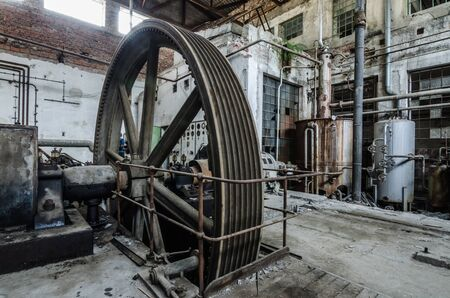 large old drive wheel in a factory