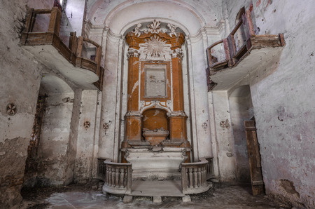 altar and balconies in abandoned church Stock Photo