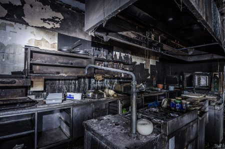 large kitchen with items after a house fire