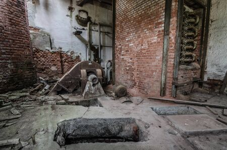 room with bricks in an abandoned factory Stock Photo