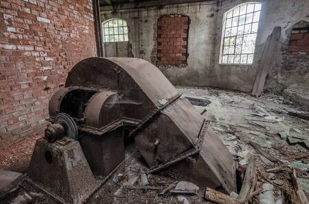 large old transmission in abandoned factory Stock Photo