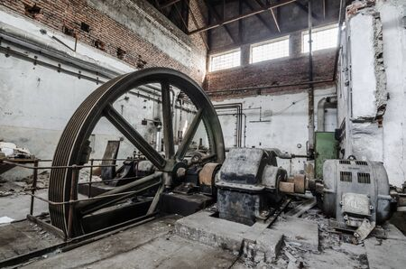 big wheel in an abandoned factory