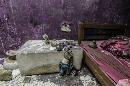 abandoned colorful hotel room with dolls