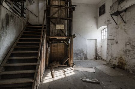 old stairs and elevator in a factory Stock Photo