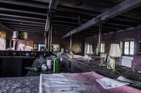 abandoned colorful bar with glasses after big fire