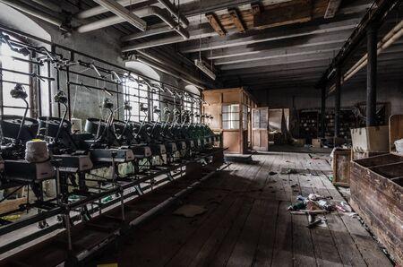 uninhabited: long weaving machine in abandoned spinning mill