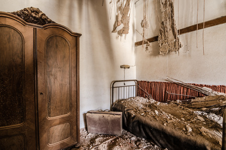 uninhabited: box and bed in an abandoned broken room