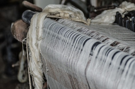 spanned: spanned yarn on old machine Stock Photo