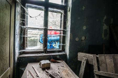 window graffiti: window with graffiti and old table
