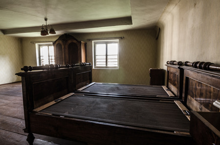 wooden bed: old wooden bed in house Stock Photo