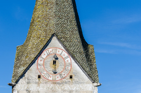 church tower with clock and blue sky