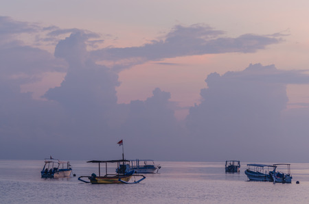 boats in the lilac colored sunrise at the sea Stock Photo