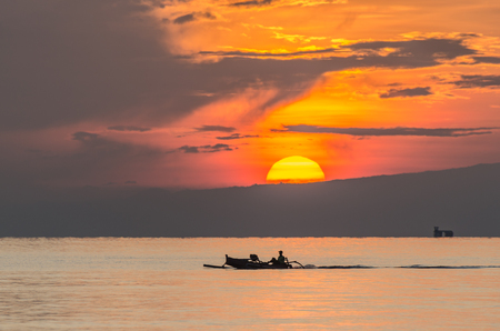 boat driving at sunrise by the sea Stock Photo