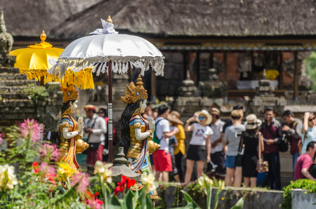 many tourists at temple sightseeing in bali