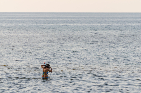 woman snorkeling in the sea and vacation