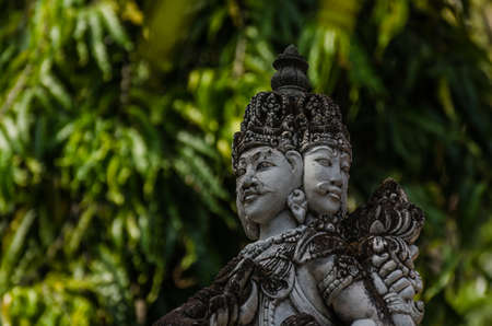 sculpture with double face in a temple on bali Stock Photo