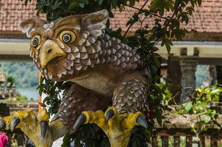 colorful eagle statue in a temple in Bali