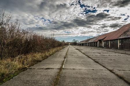 uninhabited: many garages and concrete in abandoned barracks