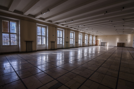 large empty hall in old barracks Editorial