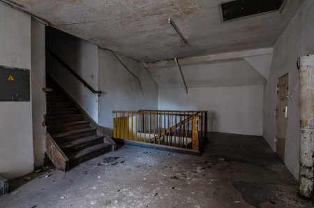 stairs and railings in abandoned barracks