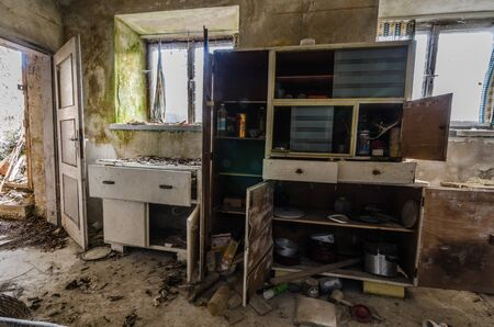 abandoned kitchen with boxes in a farmhouse