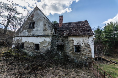 old abandoned farmhouse in the wood and mountain Stock Photo