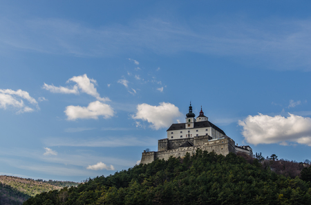 castle on the mountain and blue sky with clouds Stock Photo