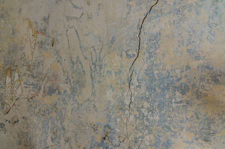 old wall with crack and wallpaper in a house Imagens