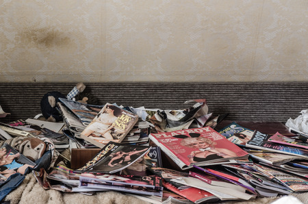 many playboy folders in old abandoned house