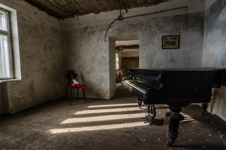 sun and shadow at a piano in a house
