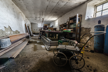 abandoned workshop with old car