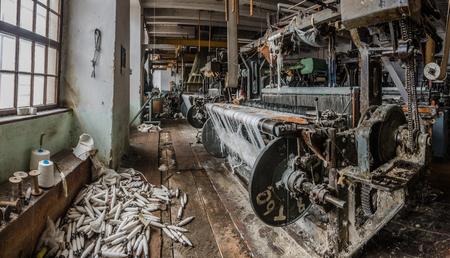 machines with many yarn bobbins panorama view