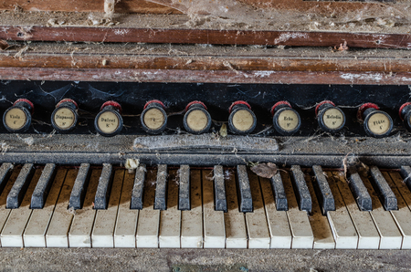 old wooden organ with dirt and dust