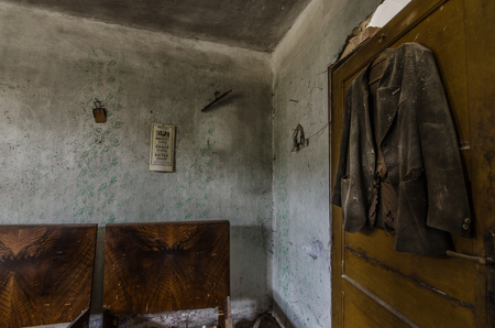 jacket in abandoned bedroom of old house