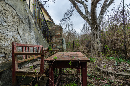 garden bench from abandoned house with garden Stock Photo