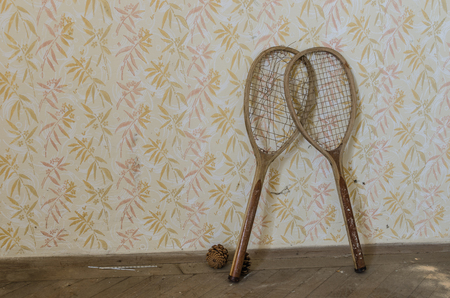 two tennis rackets in abandoned house Imagens