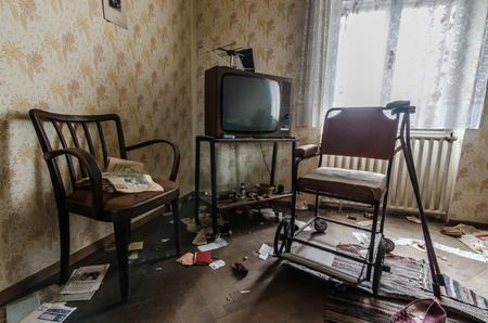 old room with a rollator in an uninhabited house