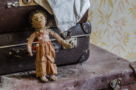 old doll in abandoned house closeup Stok Fotoğraf