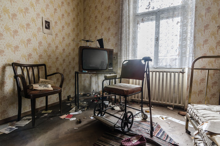 television and rollator in room of abandoned house