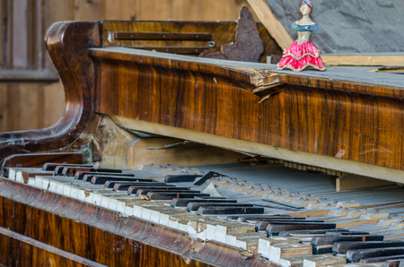 broken old piano in a house