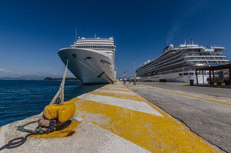 two cruise ships in the harbor on the sea