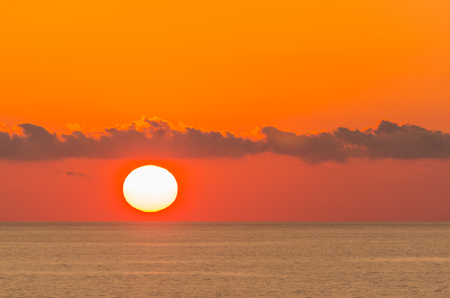bright sunrise by the sea with clouds