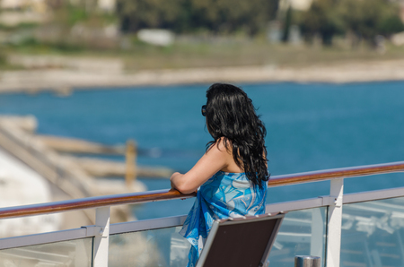woman on the ship looks at the sea