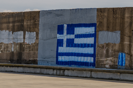 painted flag on a wall in greece