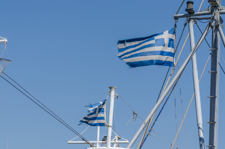 a few Greek flags on a ship Stock Photo