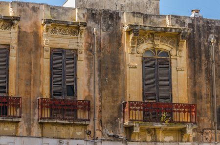 rusty balconies of old villa in italy