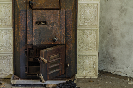 rusty stove in an old house