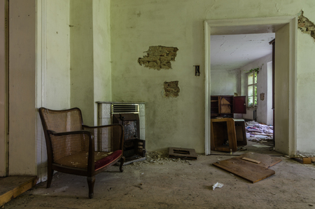 armchairs by an oven in an abandoned house